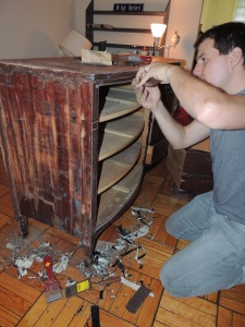 Kyle, delicately scraping the awful old paint job off of the wonderful details in the dresser.