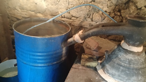 The Rakija distillation system. Dede uses this bread like mixture as a seal.