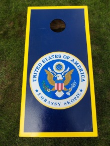 The embassy has custom corn hole boards...
