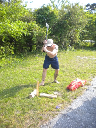 Showing off his wood chopping skills